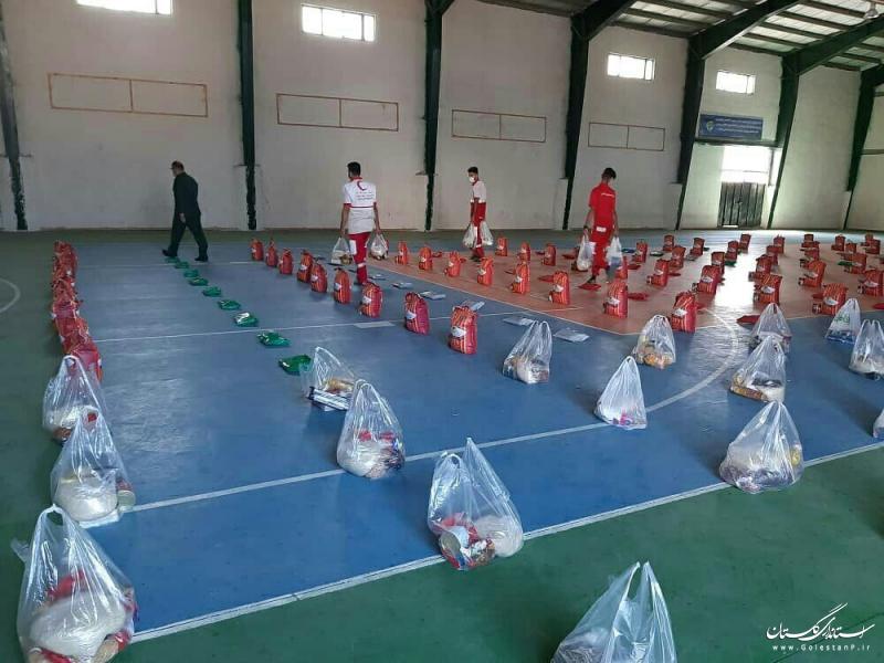 توزیع ۲۰۰ بسته غذایی میان خانواده های نیازمند بندرگزی